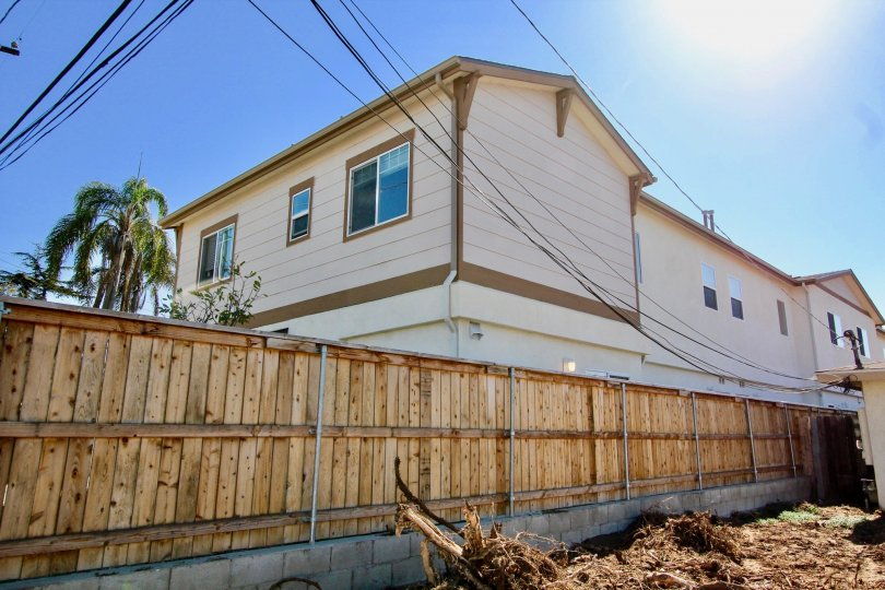 Two story building near fence at Holly Avenue in Imperial Beach California