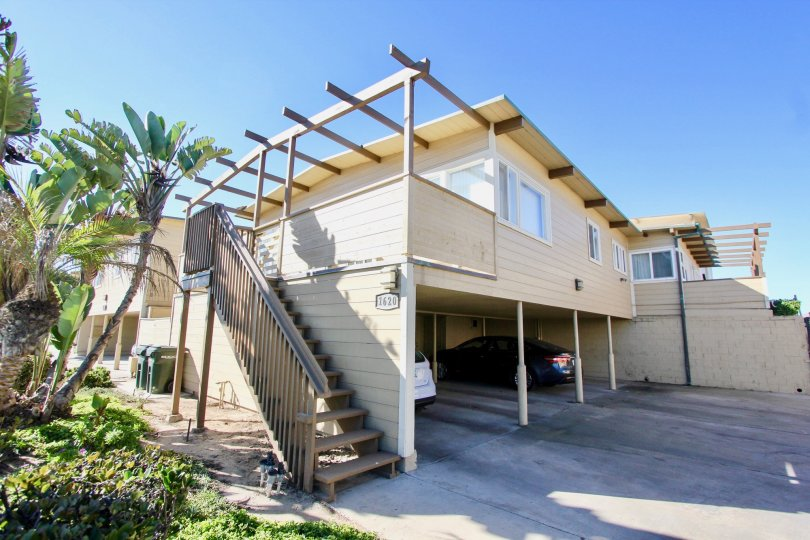 Two story housing with attached stairway and parking at La Boca Rio in Imperial Beach California