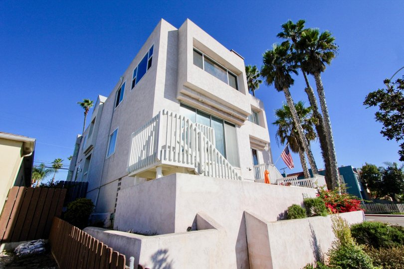 Three story housing with palm trees at Las Mareas in Imperial Beach California