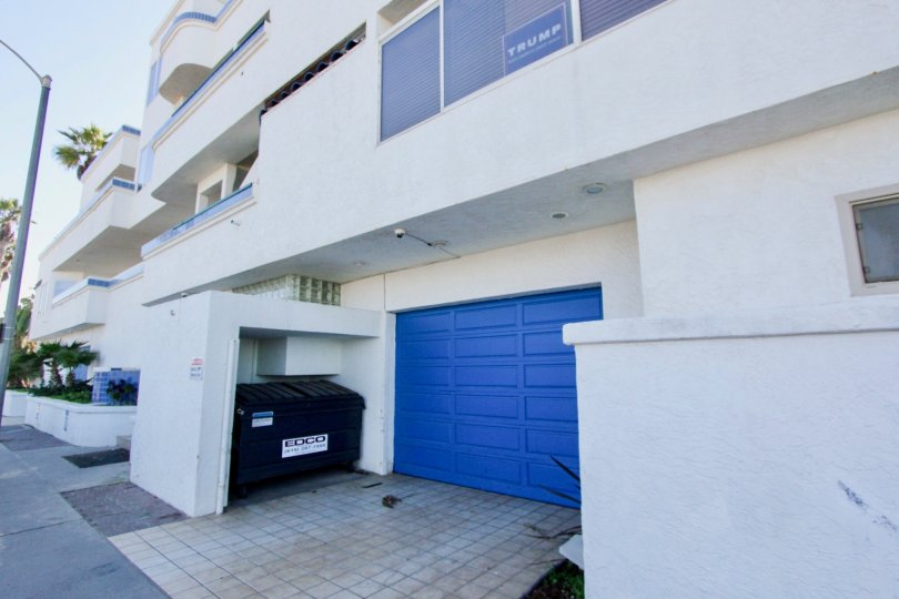 Blue garage near dumpster at Ocean Point in Imperial Beach California