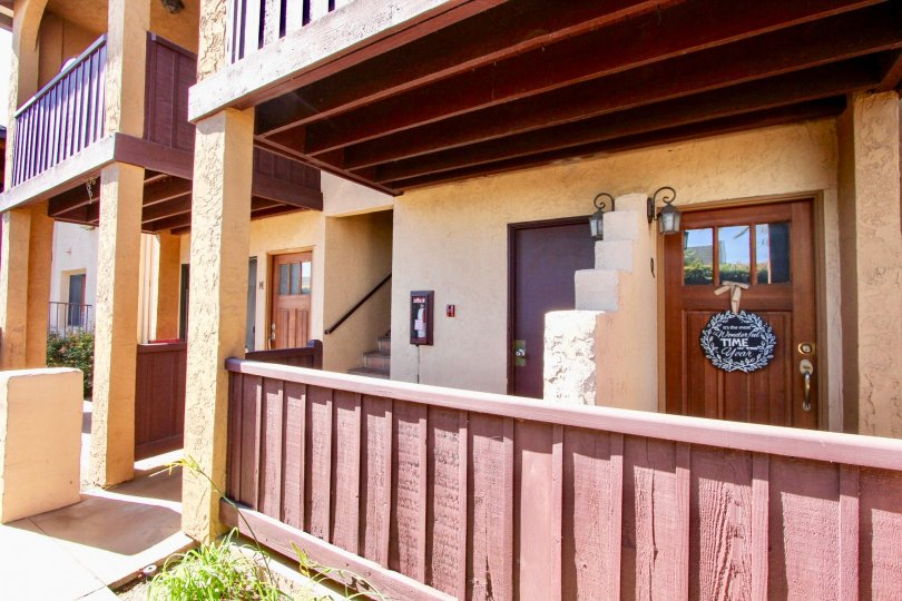 Two story housing with wooden balcony at Oh Holly in Imperial Beach California