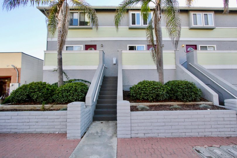 Three story housing with stairway and trees at Palm Plaza in Imperial Beach California