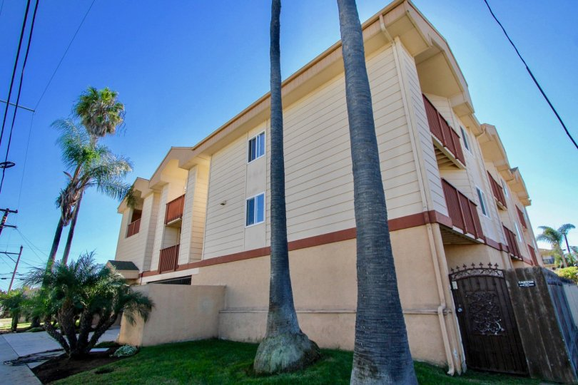 Three story residential units with security fence at Playa Dahlia in Imperial Beach California