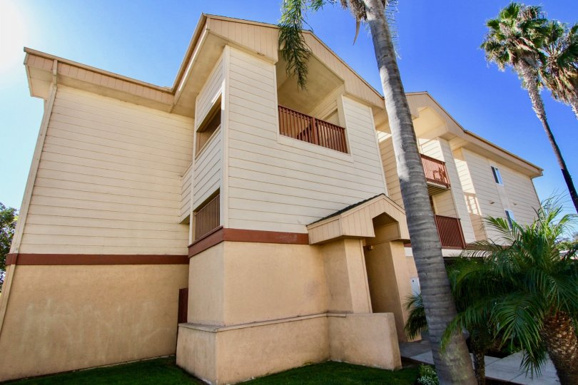 Three story residential building near palm trees at Playa Dahlia in Imperial California