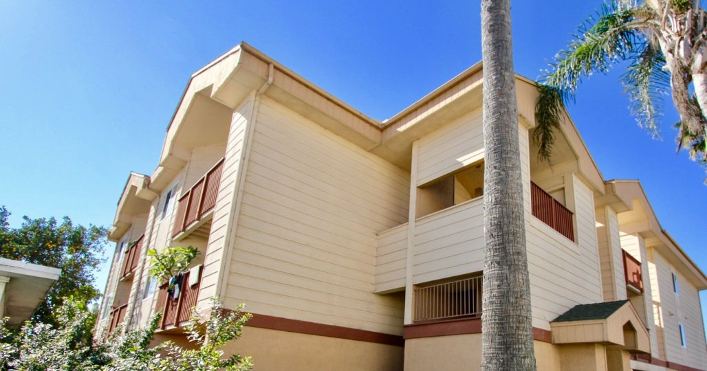 Three story town homes with brown railings at Playa Dahlia in Imperial Beach CA