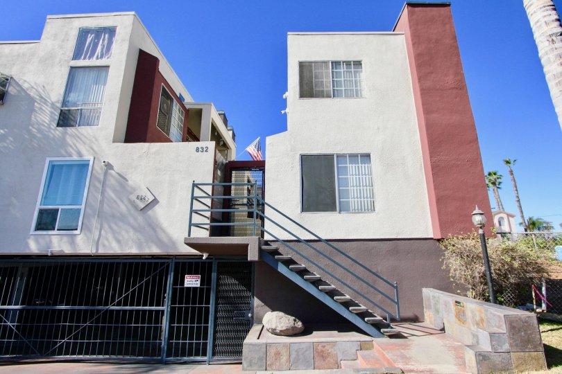 Three story housing with underground parking and marble walkway at Riviera Beach & Bay Villas in Imperial Beach CA