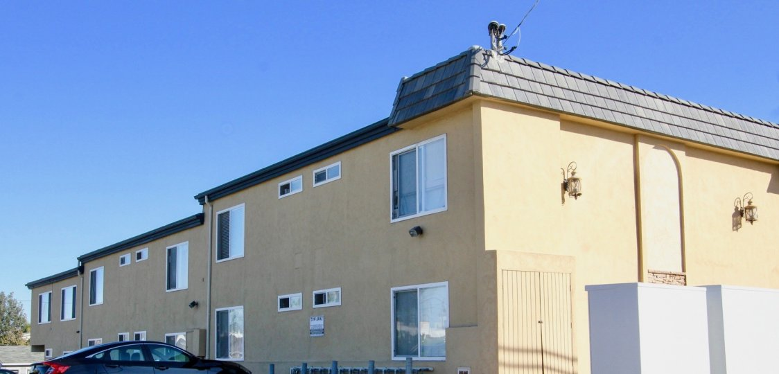 Two story apartment complex with parking at Sands Pointe in Imperial Beach CA