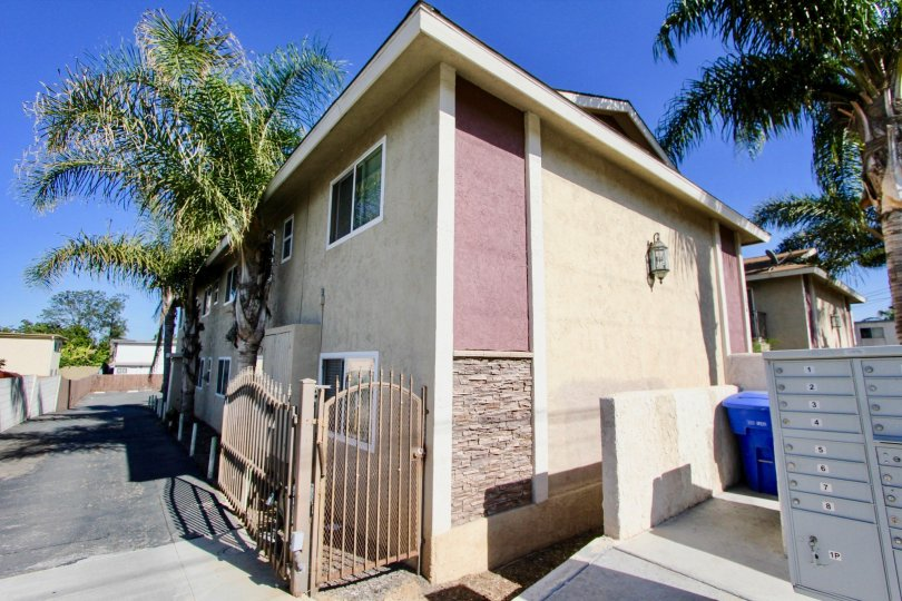 A residence in a warm climate with palm trees in the community Seabreeze Gardens.