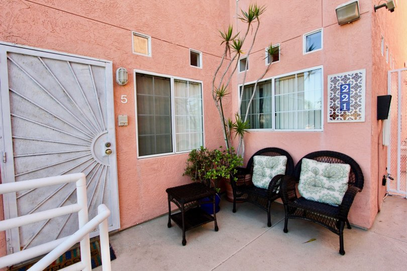 Pink apartment patio in Seaside Villas with chairs