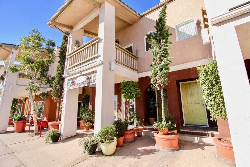 Two story pink residence in Shopkeeper at the Beach in Imperial Beach California