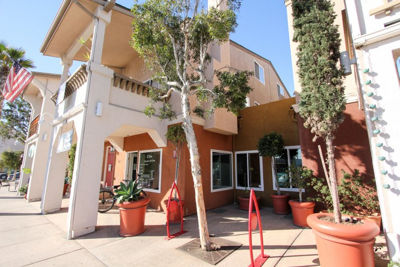 Two story residential building with windows at Shopkeeper at the Beach in Imperial Beach California