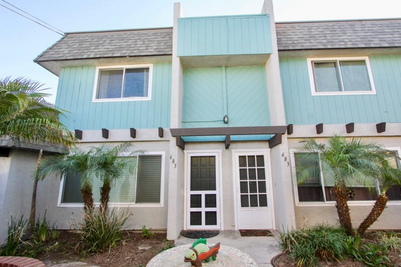 turquoise townhouse in the community of Silver Strand Gardens