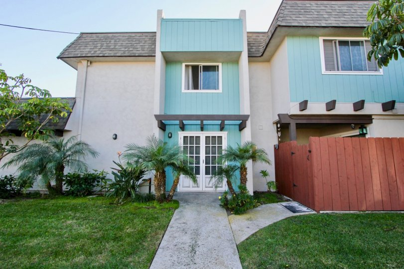 Two story housing with white doors and a yard at Silver Strand Gardens in Imperial Beach California