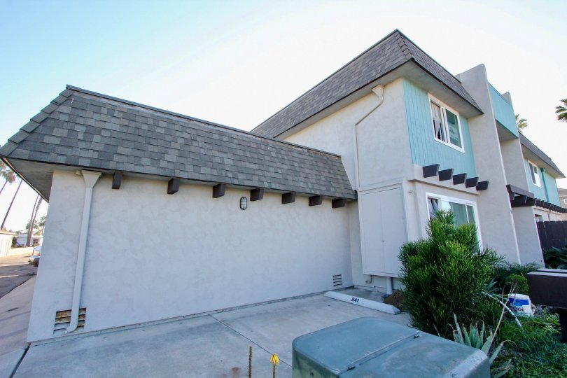 Three story residential units near street at Silverstrand Gardens in Imperial Beach California