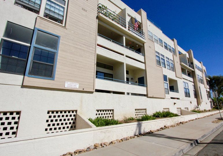 Three story residential units near street at Summer Sea in Imperial Beach California