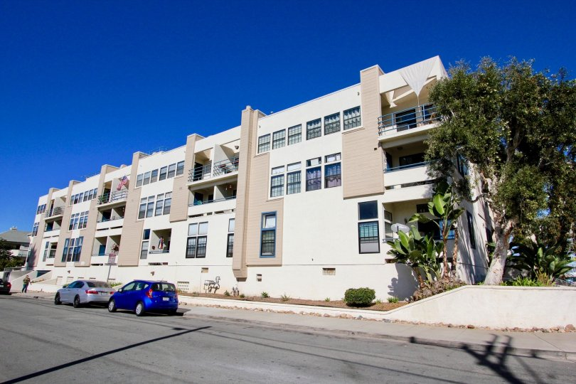 Three story residential buildings near a street at Summer Sea in Imperial Beach California