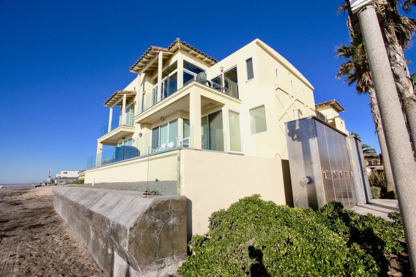 Modern three story yellow house on the beach in Wavecrest, Imperial Beach, California.