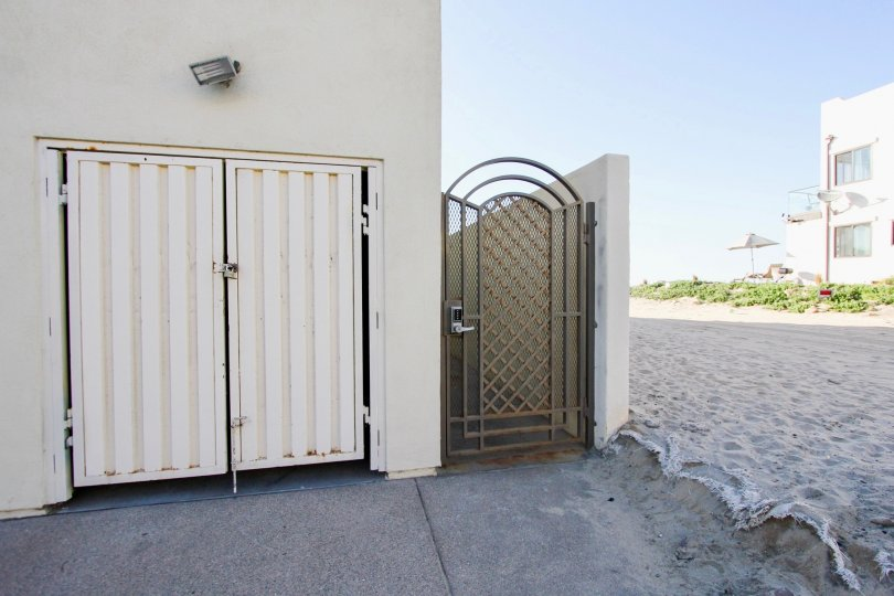 Security gate next to residential unit at Wavecrest in Imperial Beach California