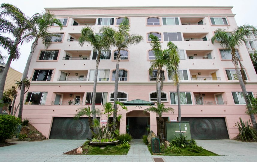 An upscale, five story apartment complex, surrounded by beautiful palm trees, at 1039 Coast Blvd. South in the city of La Jolla, California.
