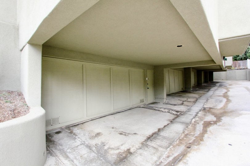 Giant garage doors near wet pavement in 265 Coast at La Jolla CA