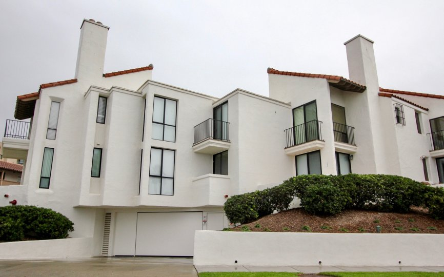 Three story white condos inside 303 Coast in La Jolla CA