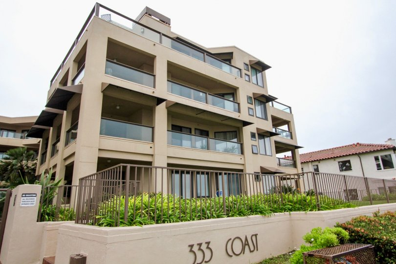 Four story residential unit with glass railing at 333 Coast in La Jolla California