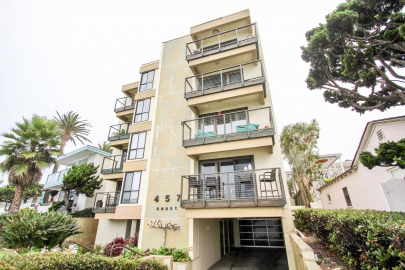 457 Coast's five story residential units near trees in La Jolla California