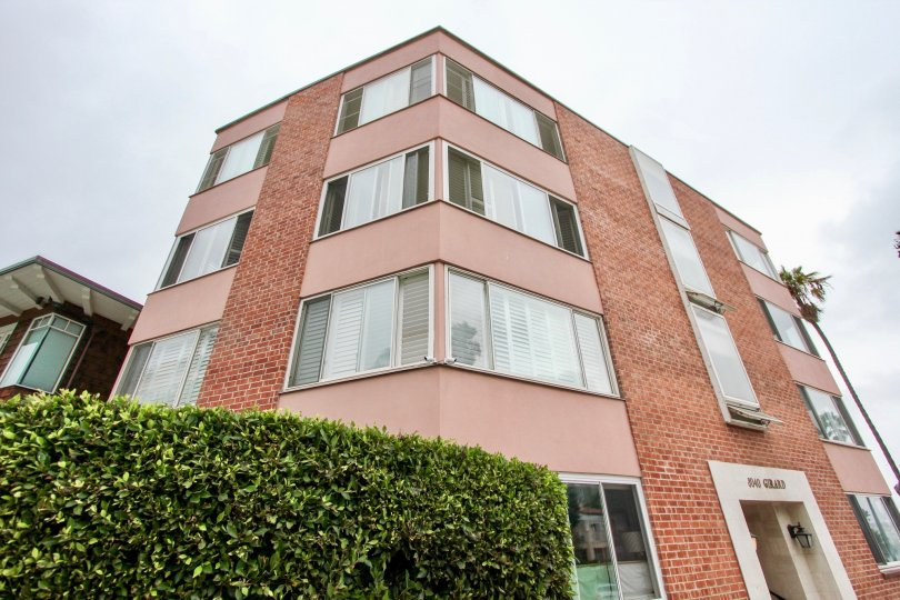 Four story brick building located at 8040 Girard Condos in La Jolla CA