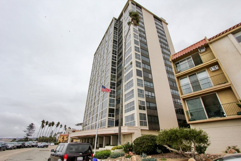 Residential high rise wit tall American flag at 939 Coast in La Jolla CA