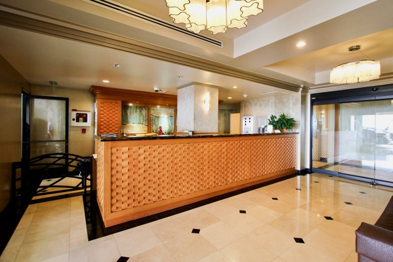 The reception hall in the 939 coast and has sofa and lift