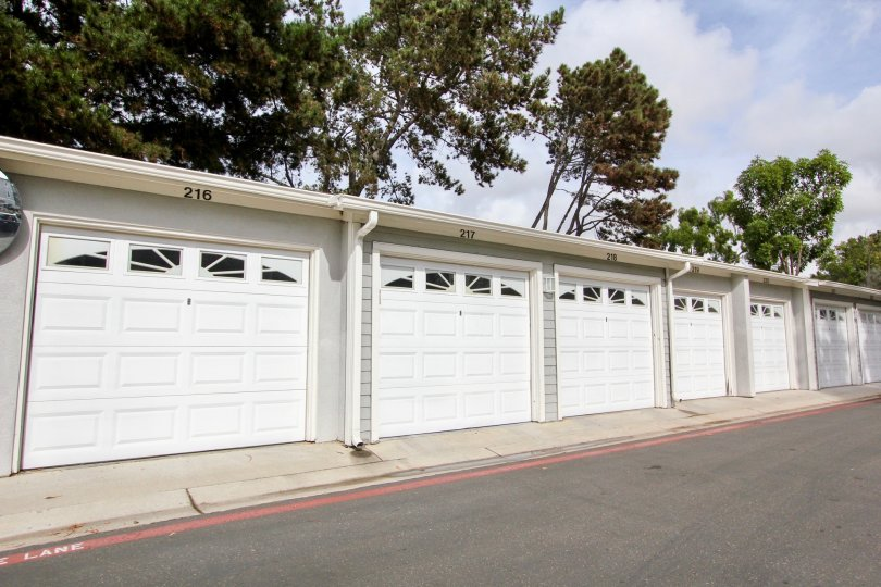 Cape La Jolla Gardens row of white garages near driveway in La Jolla California