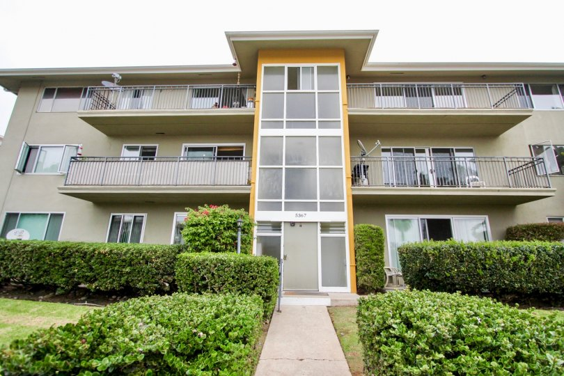 Thre story housing with walkway and plants at Capri Aire in La Jolla CA