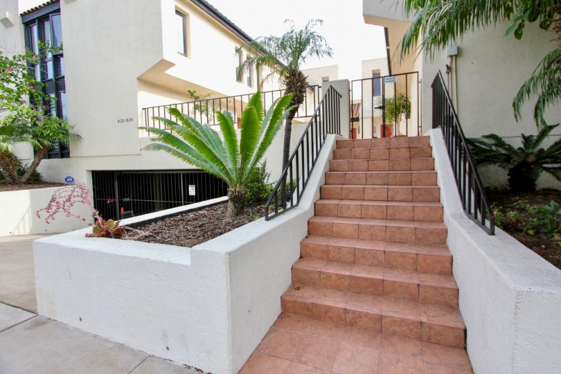 White lovely home with staircase in Casa Del Grande, La Jolla CA