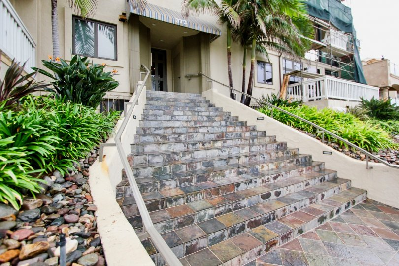 Marble stone steps leading up to a residential building at Coast Pointe in La Jolla California