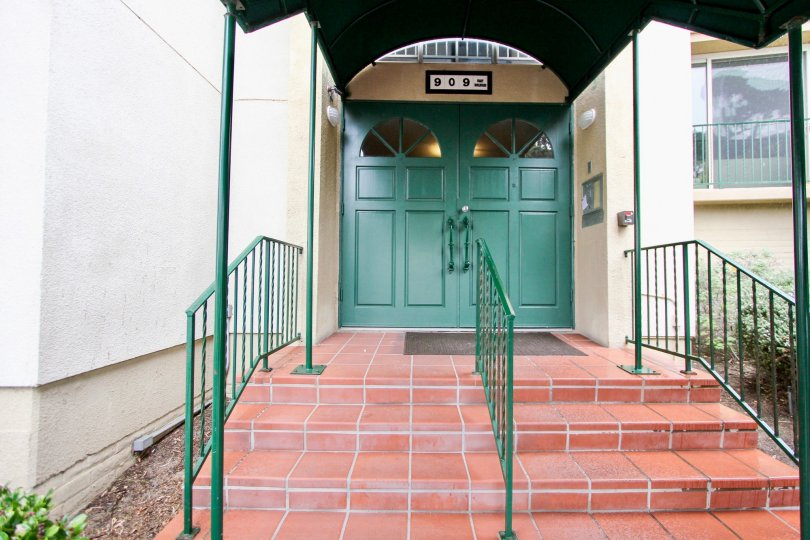 Green doors at black canopy at Coast Regency in La Jolla CA