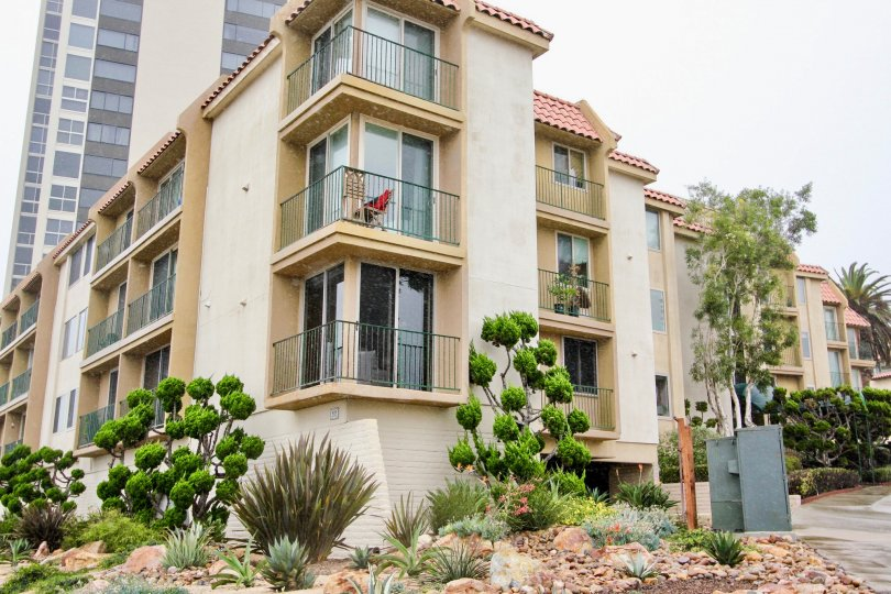 Four story residential units with balcony and plants at Coast Regency in La Jolla CA