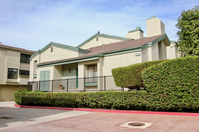 Single story home with green & brown roof at Eastbluff in La Jolla CA