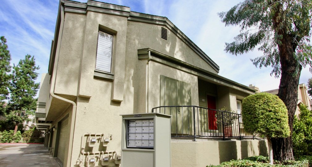 Two story single home with a black railing and plants at Eastbluff in La Jolla CA