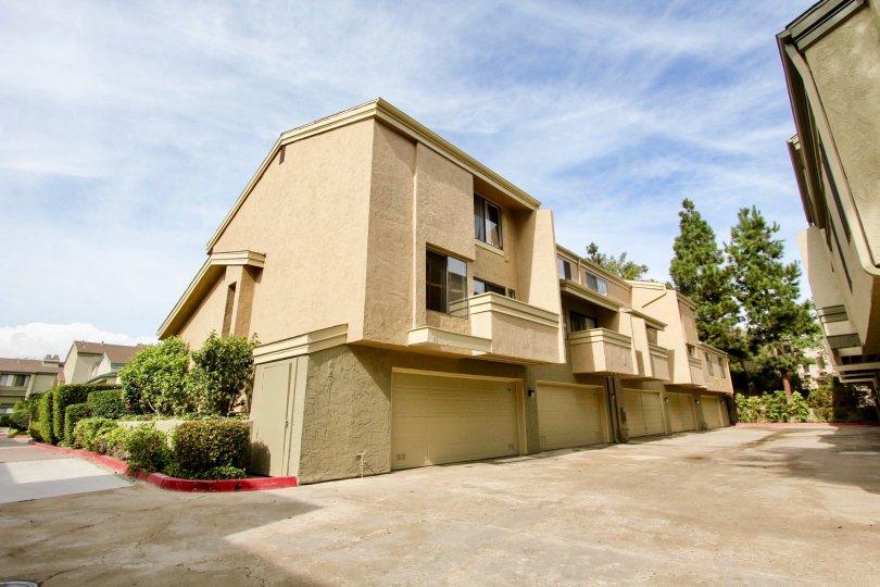 Three story brown condominiums inside the Eastbluff community in La Jolla CA