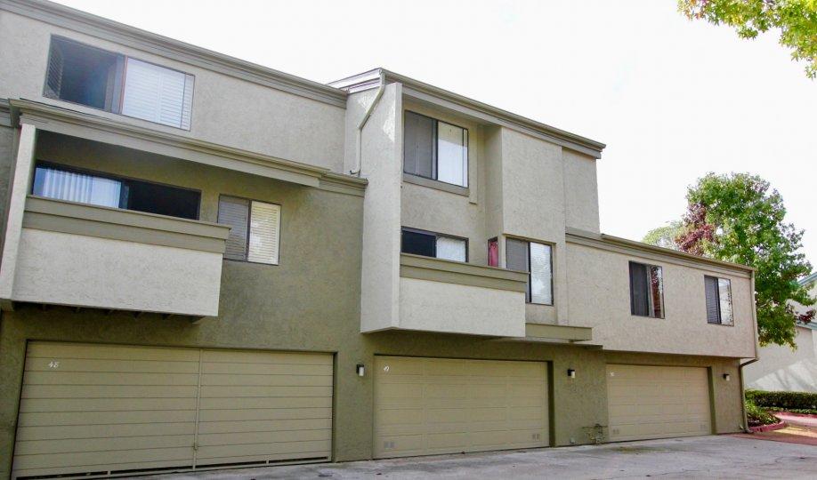 Three story housing with garages & windows inside Eastbluff in La Jolla CA