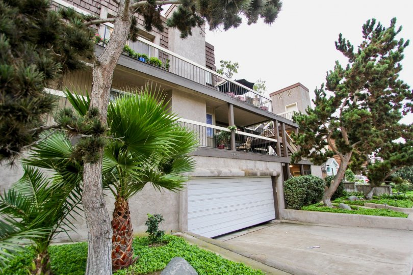 The garage and plants in front of the Herschel Condo complex community of La Jolla, California.