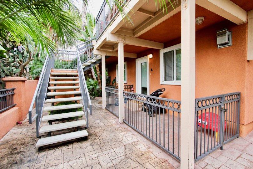 Stairway leading up to an orange residence at Herschel Estates in La Jolla California