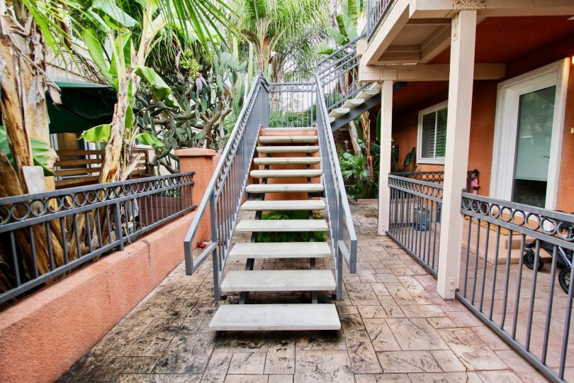outdoor staircase from ground floor to first floor in Herschel Estates community in La Jolla, CA
