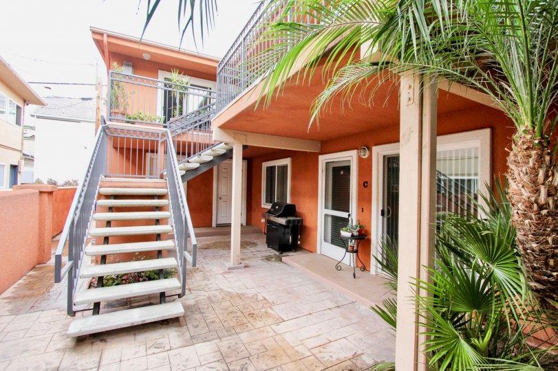 Tall orange building with stairway inside Herschel Estates in La Jolla CA