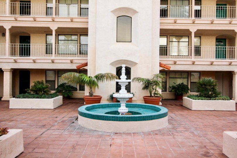 Three story housing & fountain inside La Flor De La Jolla in La Jolla CA