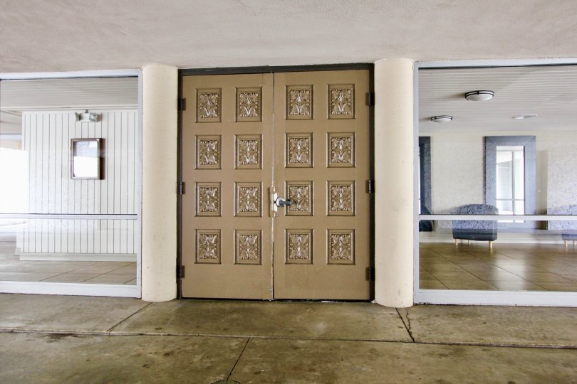 Two large brown doors inside La Jolla Estates in La Jolla CA