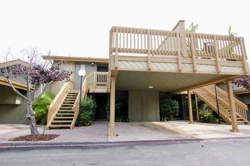 Two story residential units with wooden stairways inside La Jolla Park Villas in La Jolla CA