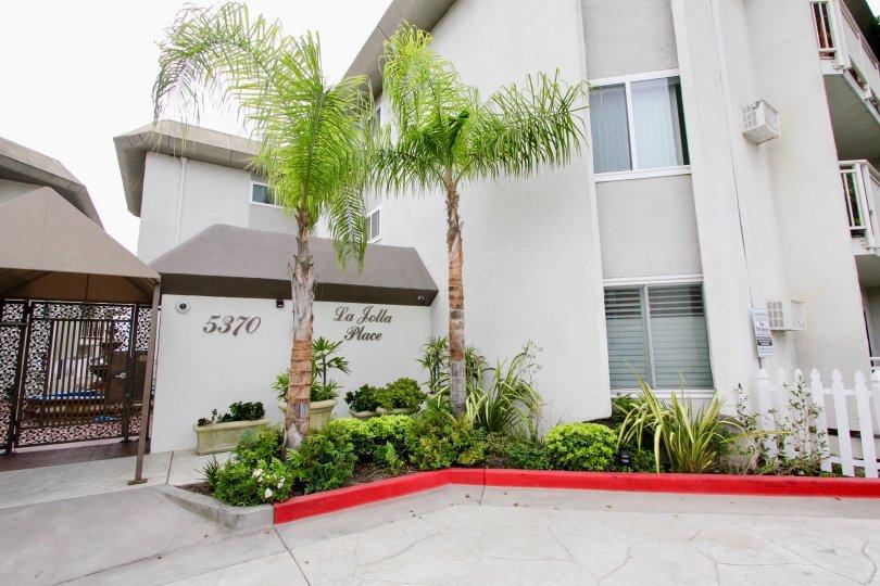 Red curb near gray condo homes inside La Jolla Place in La Jolla CA