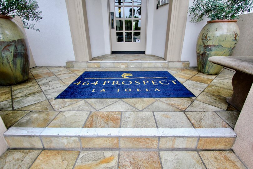 "IN entrance, Mat has "" 464 prospect la jolla"" lines in the La JOlla Prospect Condos"