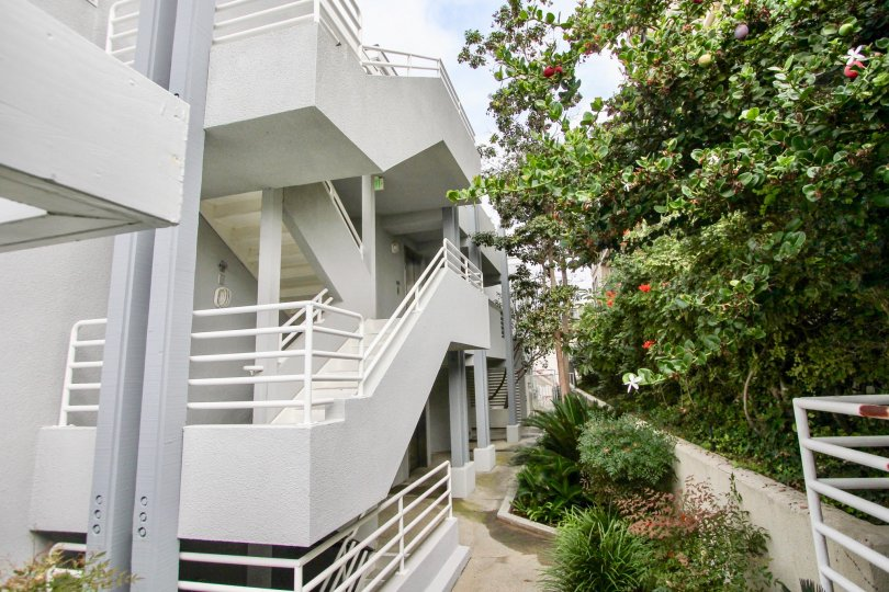 A large stairwell that is white and wide located in LJ Windigo community.